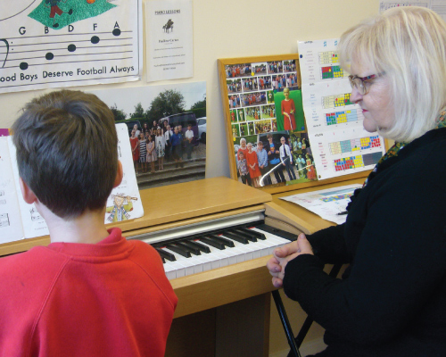 pauline and student playing piano